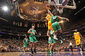 Kobe Bryant of the Los Angeles Lakers goes for a dunk against Paul Pierce of the Boston Celtics in Game Seven of the 2010 NBA Finals on June 17 2010...