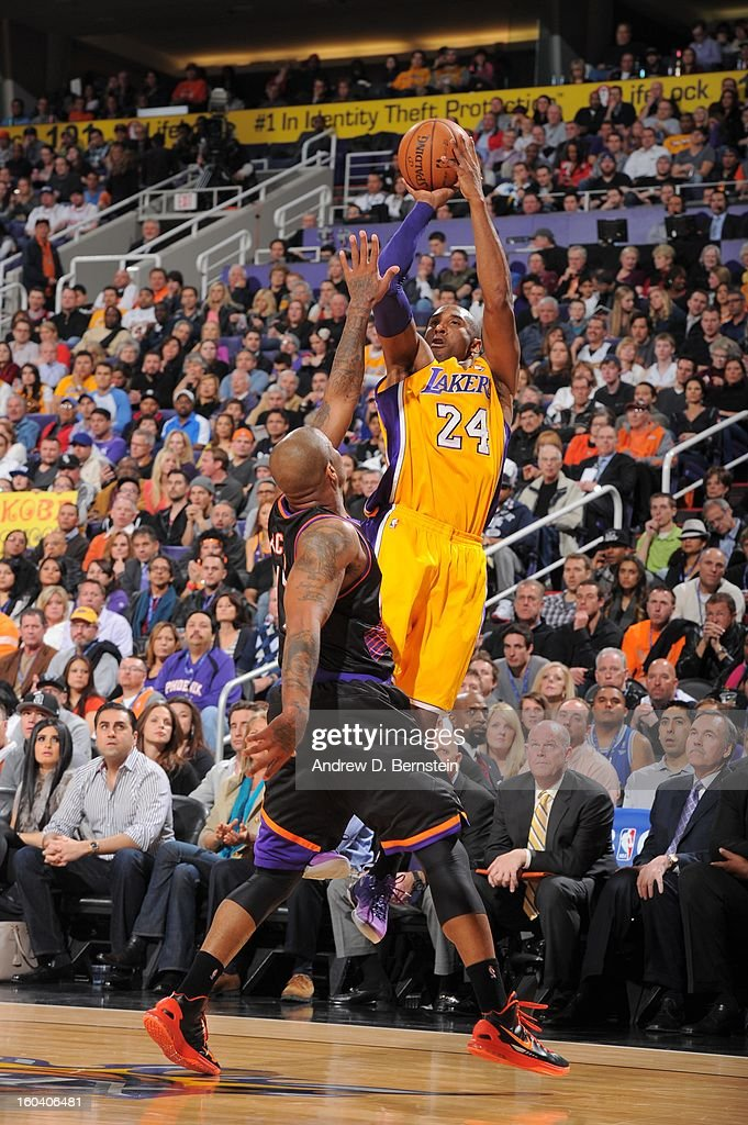 Kobe Bryant #24 of the Los Angeles Lakers goes for a jump shot during the game between the Los Angeles Lakers and the Phoenix Suns at US Airways Center on January 30, 2013 in Phoenix, Arizona.