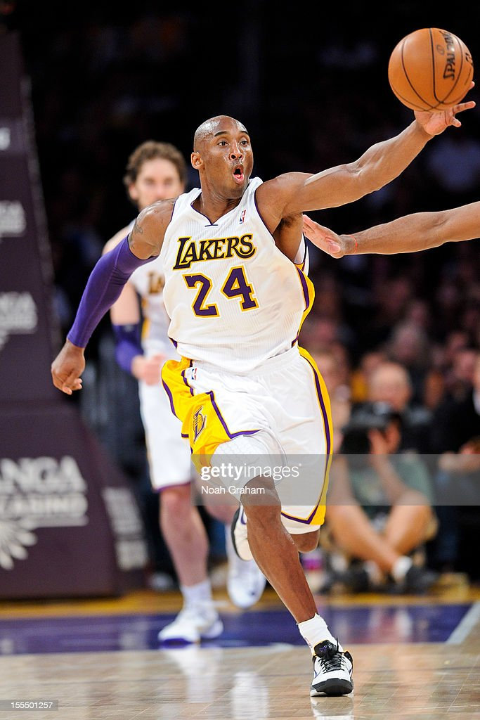 <a gi-track='captionPersonalityLinkClicked' href=/galleries/search?phrase=Kobe+Bryant&family=editorial&specificpeople=201466 ng-click='$event.stopPropagation()'>Kobe Bryant</a> #24 of the Los Angeles Lakers goes for a loose ball against the Detroit Pistons at Staples Center on November 4, 2012 in Los Angeles, California.