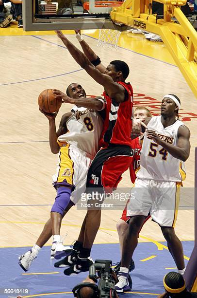 Kobe Bryant of the Los Angeles Lakers goes strong to the hoop against Chris Bosh of the Toronto Raptors on January 22 2006 at Staples Center in Los...