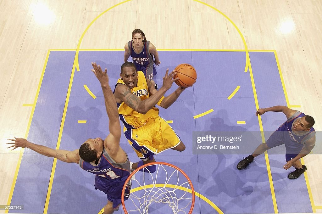 Kobe Bryant of the Los Angeles Lakers goes strong to the hoop against Shawn Marion Steve Nash and Boris Diaw of the Phoenix Suns in game six of the...