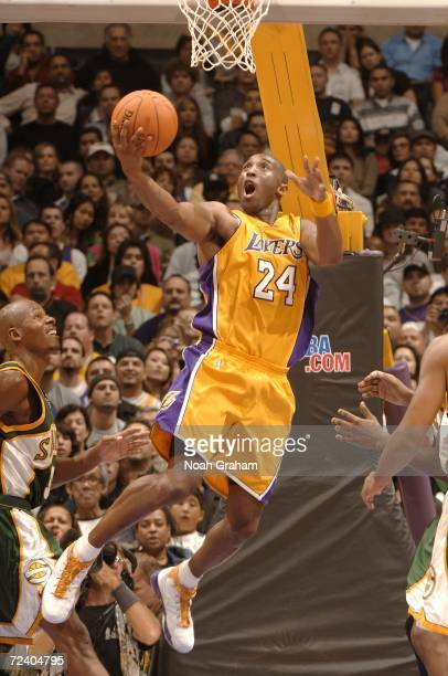 Kobe Bryant of the Los Angeles Lakers goes strong to the hoop against Ray Allen of the Seattle Supersonics on November 3 2006 at Staples Center in...