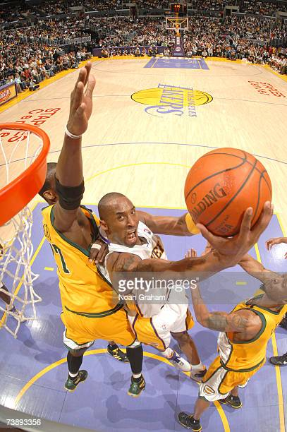 Kobe Bryant of the Los Angeles Lakers goes strong to the hoop against the Seattle Supersonics on April 15 2007 at Staples Center in Los Angeles...