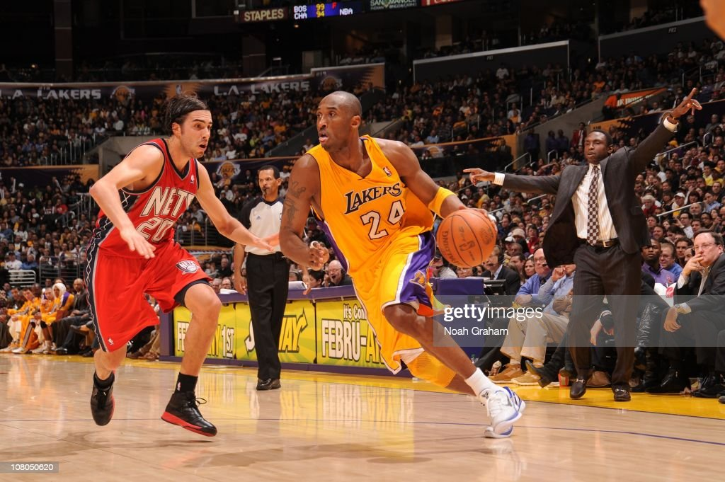 Kobe Bryant #24 of the Los Angeles Lakers goes to the basket against Sasha Vujacic #20 of the New Jersey Nets at Staples Center on January 14, 2011 in Los Angeles, California.