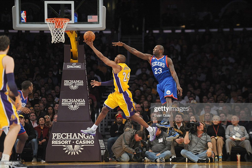 Kobe Bryant #24 of the Los Angeles Lakers goes to the basket against Jason Richardson #23 of the Philadelphia 76ers during the game between the Philadelphia 76ers and the Los Angeles Lakers at Staples Center on January 1, 2013 in Los Angeles, California.