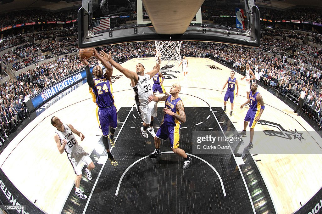 <a gi-track='captionPersonalityLinkClicked' href=/galleries/search?phrase=Kobe+Bryant&family=editorial&specificpeople=201466 ng-click='$event.stopPropagation()'>Kobe Bryant</a> #24 of the Los Angeles Lakers goes to the basket against <a gi-track='captionPersonalityLinkClicked' href=/galleries/search?phrase=Boris+Diaw&family=editorial&specificpeople=201505 ng-click='$event.stopPropagation()'>Boris Diaw</a> #33 of the San Antonio Spurs during the game between the Los Angeles Lakers and the San Antonio Spurs on January 9, 2013 at the AT&T Center in San Antonio, Texas.