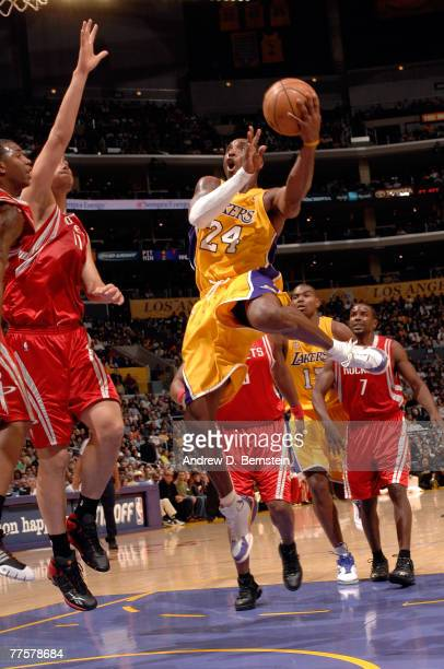 Kobe Bryant of the Los Angeles Lakers goes to the basket against Yao Ming of the Los Angeles Rockets at Staples Center on October 30 2007 in Los...