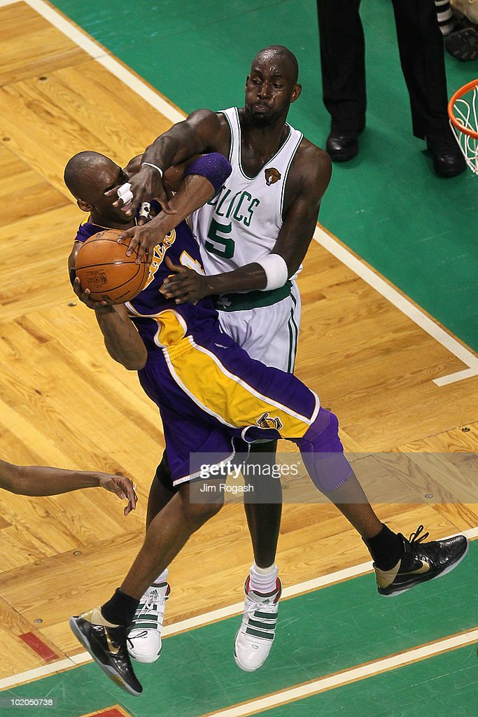 <a gi-track='captionPersonalityLinkClicked' href=/galleries/search?phrase=Kobe+Bryant&family=editorial&specificpeople=201466 ng-click='$event.stopPropagation()'>Kobe Bryant</a> #24 of the Los Angeles Lakers goes to the basket under pressure against <a gi-track='captionPersonalityLinkClicked' href=/galleries/search?phrase=Kevin+Garnett&family=editorial&specificpeople=201473 ng-click='$event.stopPropagation()'>Kevin Garnett</a> #5 of the Boston Celtics during Game Five of the 2010 NBA Finals on June 13, 2010 at TD Garden in Boston, Massachusetts. The Celtics won 92-86.
