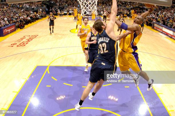 Kobe Bryant of the Los Angeles Lakers goes up for a dunk against Josh McRoberts of the Indiana Pacers at Staples Center on March 2 2010 in Los...
