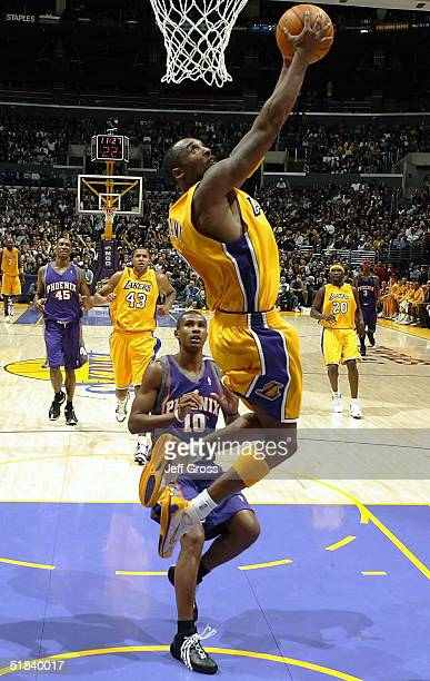 Kobe Bryant of the Los Angeles Lakers goes up for a reverse dunk in front of Leandro Barbosa of the Phoenix Suns during second half action at Staples...