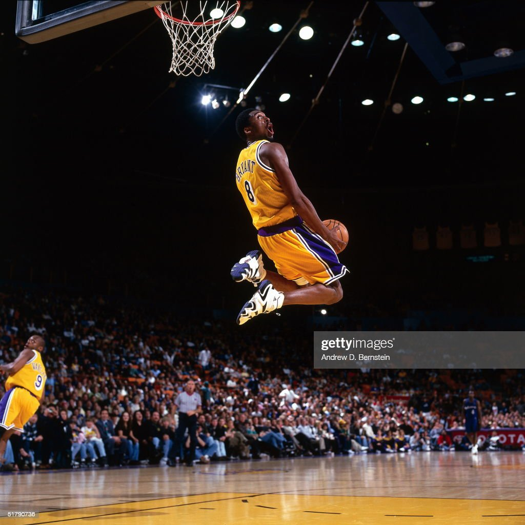 Kobe Bryant #8 of the Los Angeles Lakers goes up for a reverse slam dunk against the Minnesota Timberwolves during an NBA game at the Staples Center circa 1998 in Los Angeles, California.