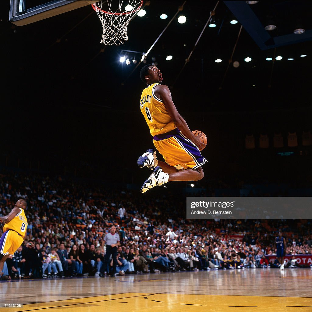 Kobe Bryant #8 of the Los Angeles Lakers goes up for a reverse slam dunk against the Minnesota Timberwolves during a 1998 NBA game at The Great Western Forum in Inglewood, California.