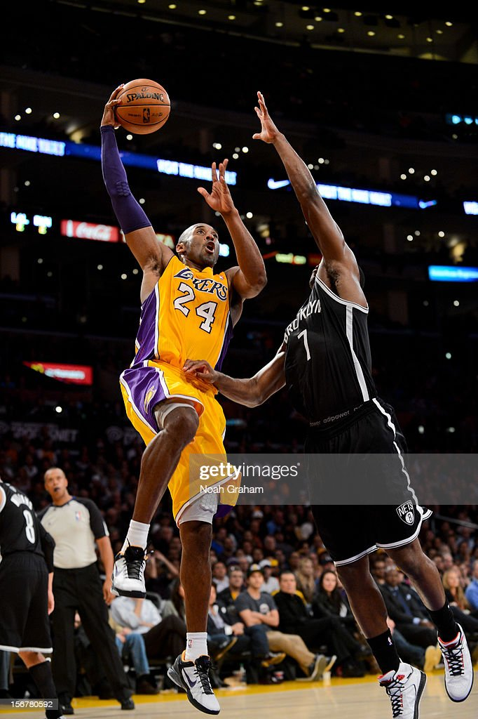 <a gi-track='captionPersonalityLinkClicked' href=/galleries/search?phrase=Kobe+Bryant&family=editorial&specificpeople=201466 ng-click='$event.stopPropagation()'>Kobe Bryant</a> #24 of the Los Angeles Lakers goes up for a shot against <a gi-track='captionPersonalityLinkClicked' href=/galleries/search?phrase=Joe+Johnson+-+Basketball+Player&family=editorial&specificpeople=201652 ng-click='$event.stopPropagation()'>Joe Johnson</a> #7 of the Brooklyn Nets at Staples Center on November 20, 2012 in Los Angeles, California.
