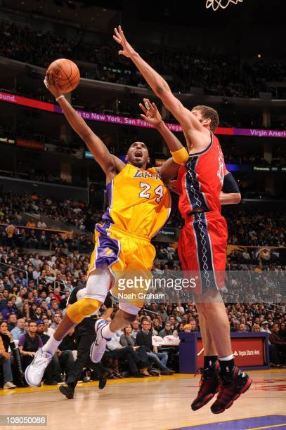 Kobe Bryant of the Los Angeles Lakers goes up for a shot against Brook Lopez of the New Jersey Nets at Staples Center on January 14 2011 in Los...
