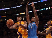 Kobe Bryant of the Los Angeles Lakers goes up for a shot against Serge Ibaka of the Oklahoma City Thunder in the first half in Game Four of the...