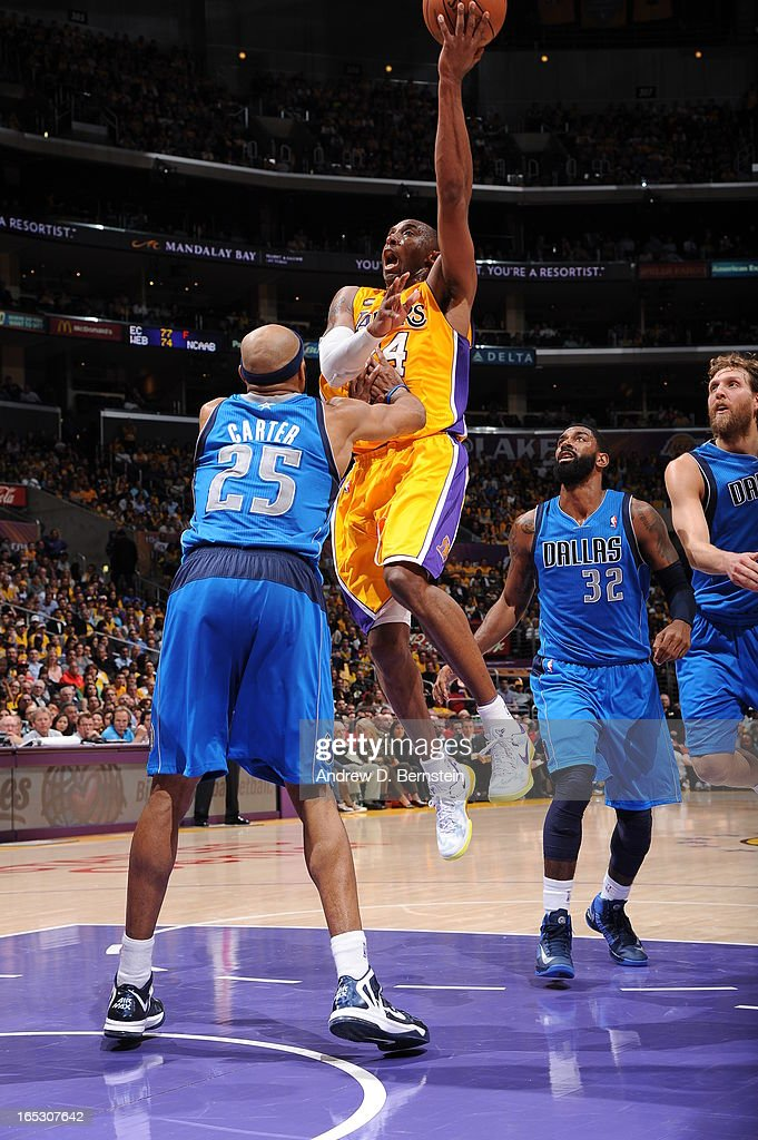 Kobe Bryant #24 of the Los Angeles Lakers goes up for a shot against Vince Carter #25 of the Dallas Mavericks at Staples Center on April 2, 2013 in Los Angeles, California.
