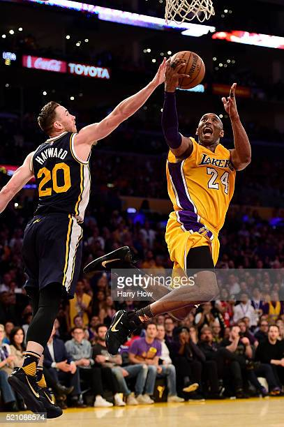 Kobe Bryant of the Los Angeles Lakers goes up for a shot against Gordon Hayward of the Utah Jazz in the fourth quarter at Staples Center on April 13...