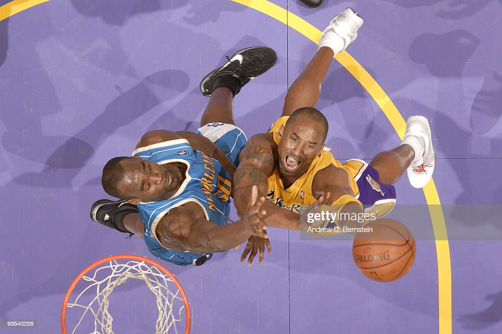 Kobe Bryant #24 of the Los Angeles Lakers goes up for a shot against Emeka Okafor #50 of the New Orleans Hornets at Staples Center on December 1, 2009 in Los Angeles, California.