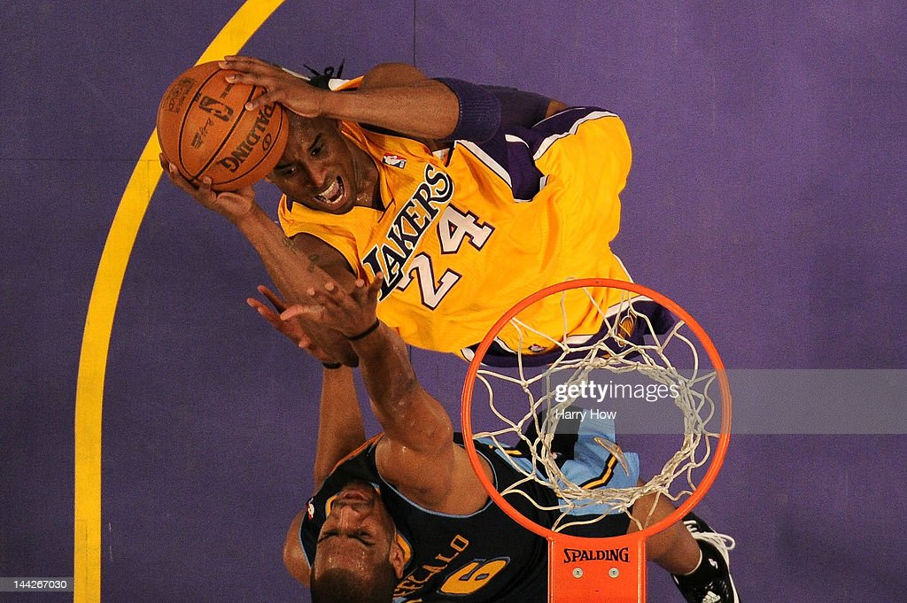 <a gi-track='captionPersonalityLinkClicked' href=/galleries/search?phrase=Kobe+Bryant&family=editorial&specificpeople=201466 ng-click='$event.stopPropagation()'>Kobe Bryant</a> #24 of the Los Angeles Lakers goes up for a shot over <a gi-track='captionPersonalityLinkClicked' href=/galleries/search?phrase=Arron+Afflalo&family=editorial&specificpeople=640861 ng-click='$event.stopPropagation()'>Arron Afflalo</a> #6 of the Denver Nuggets in the first half in Game Seven of the Western Conference Quarterfinals in the 2012 NBA Playoffs on May 12, 2012 at Staples Center in Los Angeles, California.