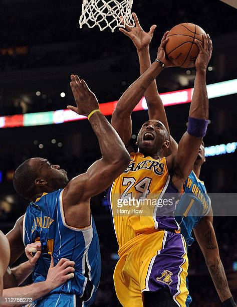 Kobe Bryant of the Los Angeles Lakers goes up for a shot over Carl Landry of the New Orleans Hornets in Game Two of the Western Conference...