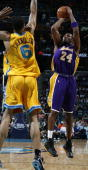 Kobe Bryant of the Los Angeles Lakers goes up for a shot while Tyson Chandler of the New Orleans/Oklahoma City Hornets tries to block on March 23...