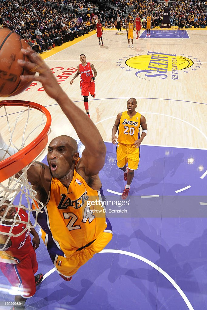 <a gi-track='captionPersonalityLinkClicked' href=/galleries/search?phrase=Kobe+Bryant&family=editorial&specificpeople=201466 ng-click='$event.stopPropagation()'>Kobe Bryant</a> #24 of the Los Angeles Lakers goes up for the dunk against the Los Angeles Clippers at Staples Center on February 14, 2013 in Los Angeles, California.