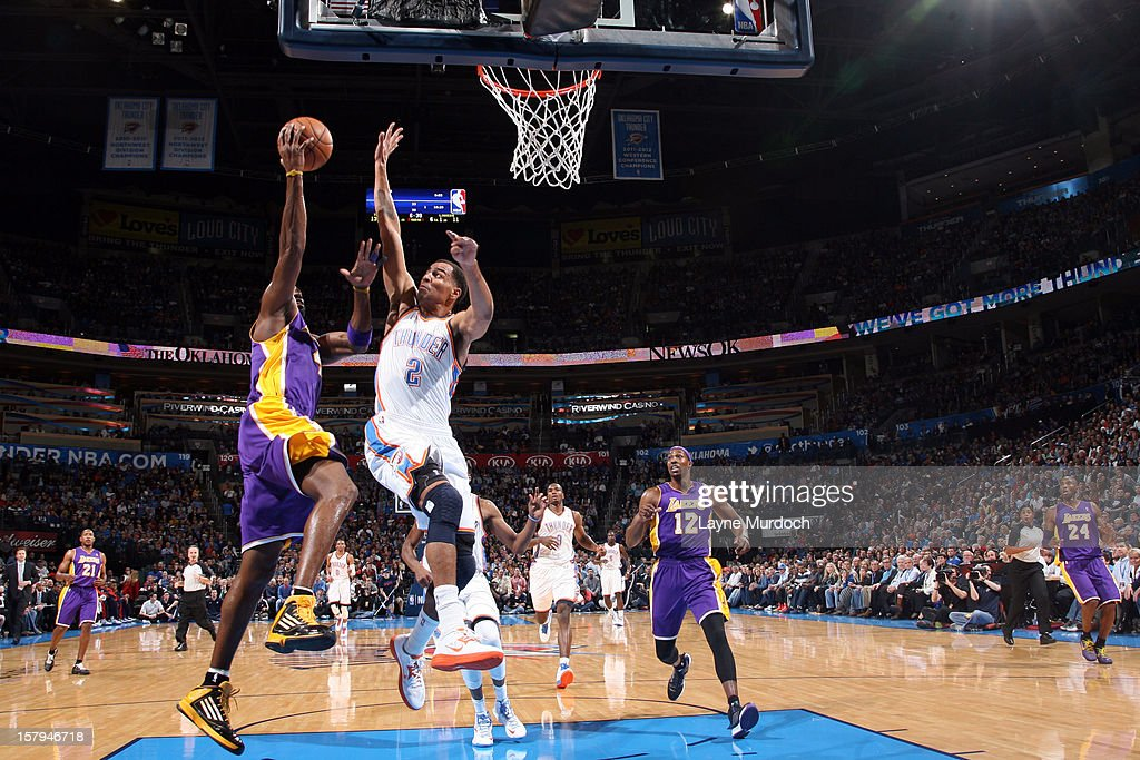 Kobe Bryant #24 of the Los Angeles Lakers goes up for the easy layup against the Oklahoma City Thunder during an NBA game on December 7, 2012 at the Chesapeake Energy Arena in Oklahoma City, Oklahoma.