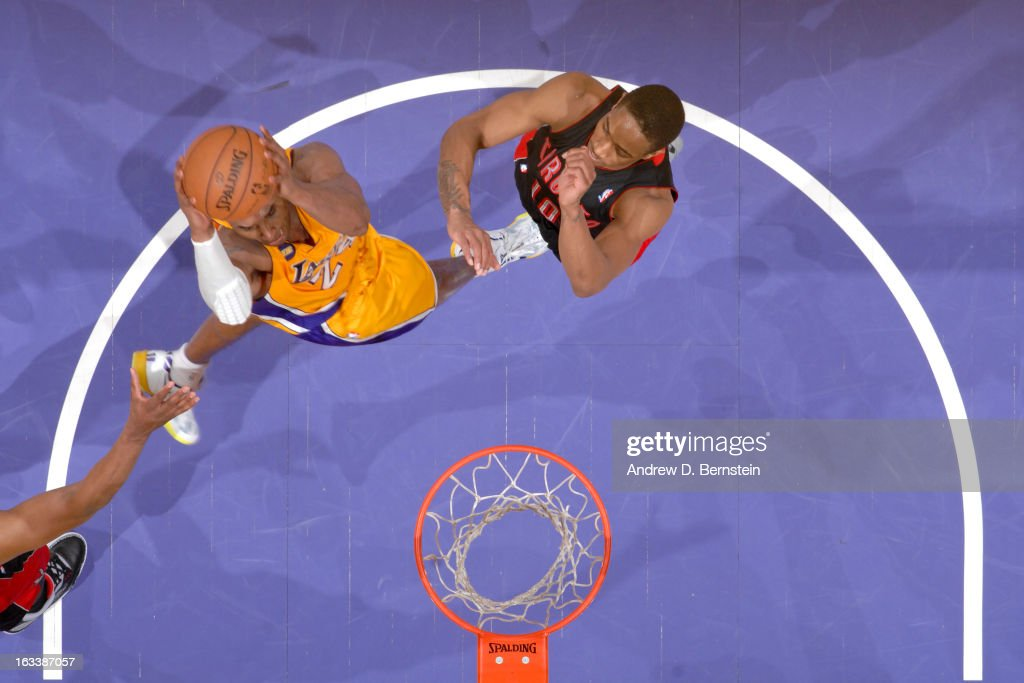 <a gi-track='captionPersonalityLinkClicked' href=/galleries/search?phrase=Kobe+Bryant&family=editorial&specificpeople=201466 ng-click='$event.stopPropagation()'>Kobe Bryant</a> #24 of the Los Angeles Lakers goes up for the go-ahead dunk in overtime against DeMar DeRozan #10 of the Toronto Raptors at Staples Center on March 8, 2013 in Los Angeles, California.