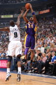 Kobe Bryant of the Los Angeles Lakers goes up for the shot against Ronnie Brewer of the Utah Jazz in Game Three of the Western Conference...