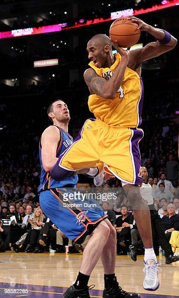 Kobe Bryant of the Los Angeles Lakers grabs a rebound in front of Nick Collison of the Oklahoma City Thunder during Game Two of the Western...