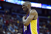 Kobe Bryant of the Los Angeles Lakers grabs his right shoulder during a game against the New Orleans Pelicans at the Smoothie King Center on January...
