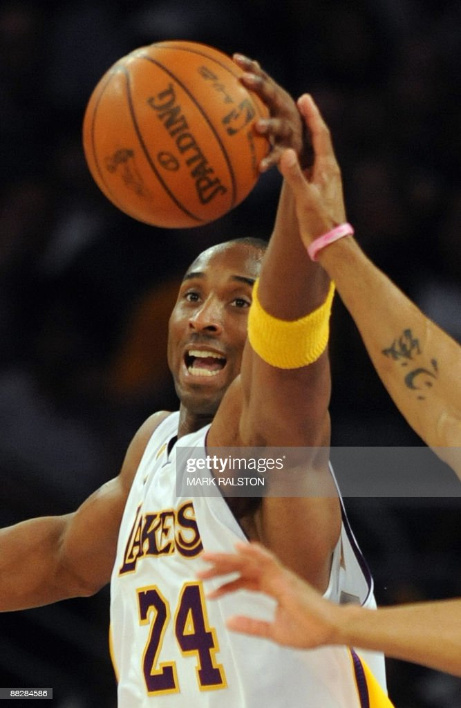 Kobe Bryant of the Los Angeles Lakers grabs the ball as they play Orlando Magic during game two of the NBA finals at the Staples Center in Los Angeles on June 7, 2009. The Lakers who lead the series 1-0, are playing in the finals for the second-straight year and Orlando are making their second trip to the showcase in 14 years. AFP PHOTO/Mark RALSTON