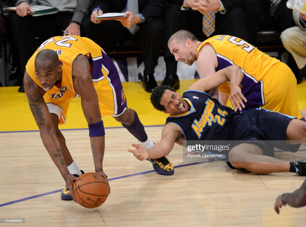 <a gi-track='captionPersonalityLinkClicked' href=/galleries/search?phrase=Kobe+Bryant&family=editorial&specificpeople=201466 ng-click='$event.stopPropagation()'>Kobe Bryant</a> #24 of the Los Angeles Lakers grabs the ball in front of <a gi-track='captionPersonalityLinkClicked' href=/galleries/search?phrase=Andre+Miller&family=editorial&specificpeople=201678 ng-click='$event.stopPropagation()'>Andre Miller</a> #24 of the Denver Nuggets in the second quarter in Game Seven of the Western Conference Quarterfinals in the 2012 NBA Playoffs on May 12, 2012 at Staples Center in Los Angeles, California.