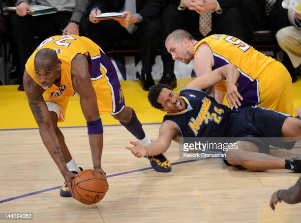 Kobe Bryant of the Los Angeles Lakers grabs the ball in front of Andre Miller of the Denver Nuggets in the second quarter in Game Seven of the...