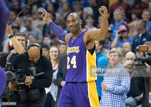 Kobe Bryant of the Los Angeles Lakers greets fans before the first quarter of a NBA game against the Oklahoma City Thunder during his last road game...
