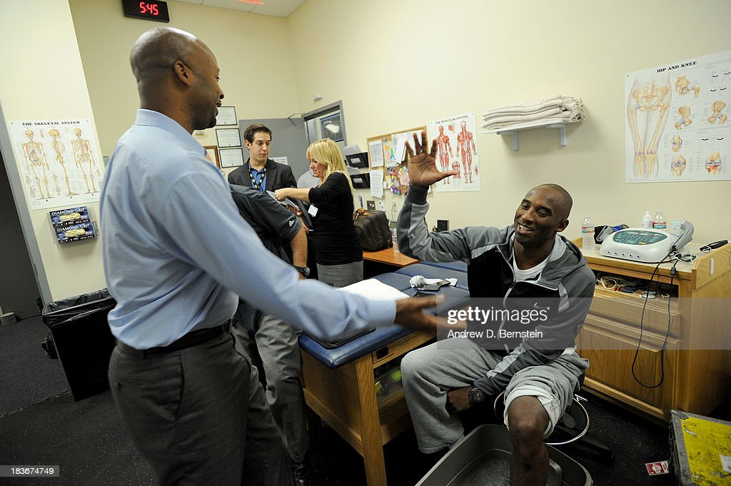 <a gi-track='captionPersonalityLinkClicked' href=/galleries/search?phrase=Kobe+Bryant&family=editorial&specificpeople=201466 ng-click='$event.stopPropagation()'>Kobe Bryant</a> #24 of the Los Angeles Lakers greets Head Coach Brian Shaw of the Denver Nuggets at Citizens Business Bank Arena on October 8, 2013 in Ontario, California.