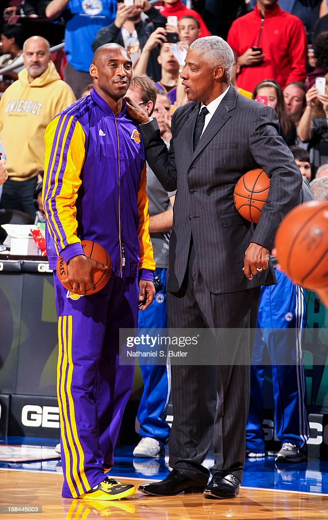 Kobe Bryant #24 of the Los Angeles Lakers greets NBA legend Julius Erving before a game against the Philadelphia 76ers on December 16, 2012 at the Wells Fargo Center in Philadelphia, Pennsylvania.