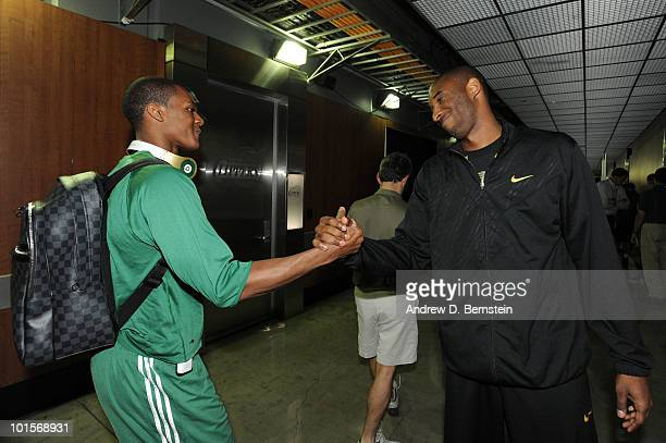 Kobe Bryant of the Los Angeles Lakers greets Rajon Rondo of the Boston Celtics after practice in preparation for Game One of the NBA Finals at...