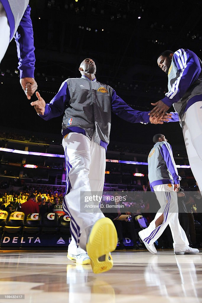 Kobe Bryant #24 of the Los Angeles Lakers greets teammates before playing against the Cleveland Cavaliers at Staples Center on January 13, 2013 in Los Angeles, California.