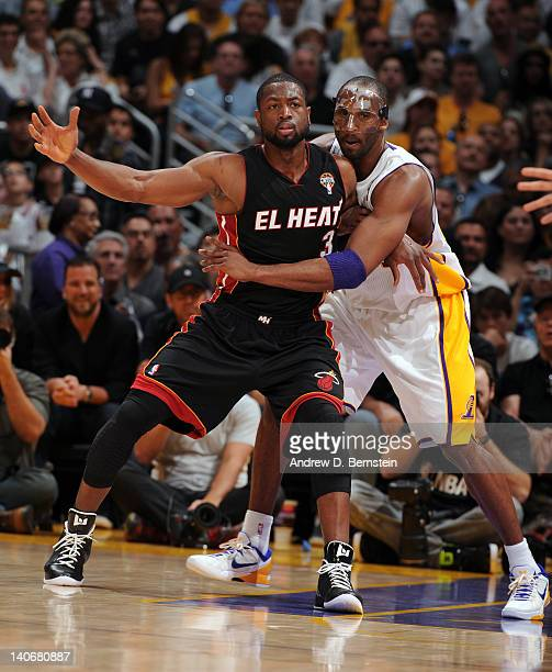 Kobe Bryant of the Los Angeles Lakers guards Dwyane Wade of the Miami Heatduring the game between the Miami Heat and the Los Angeles Lakers at...