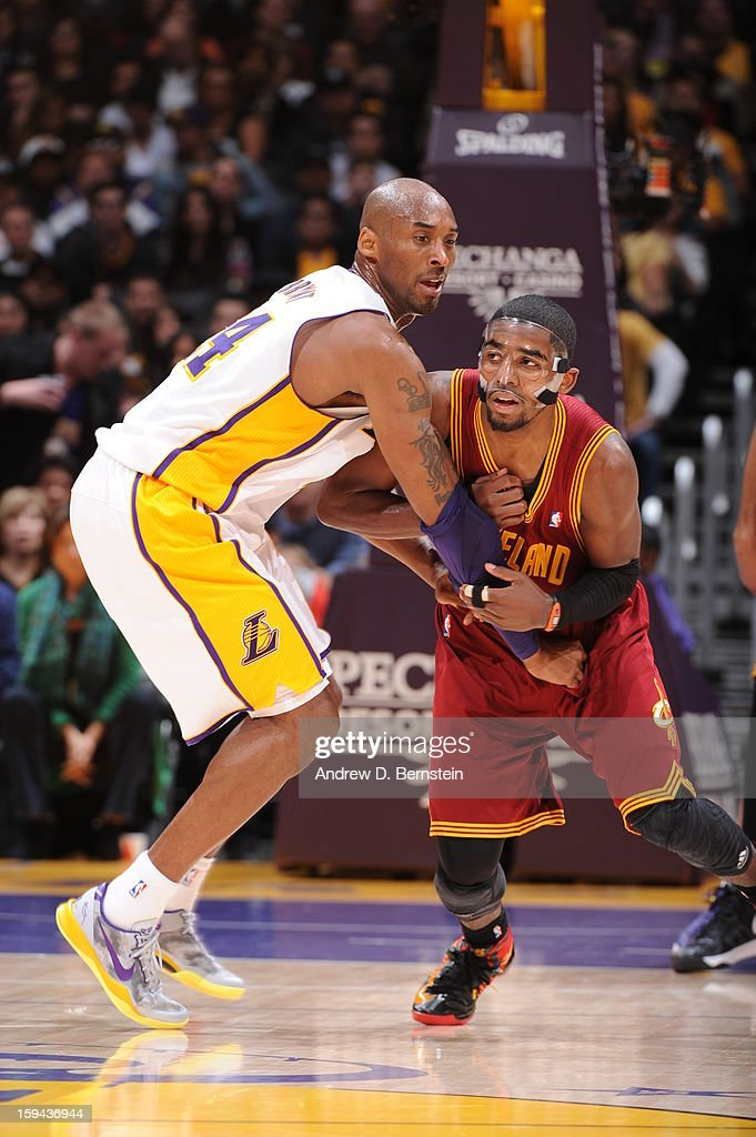 Kobe Bryant #24 of the Los Angeles Lakers guards Kyrie Irving #2 of the Cleveland Cavaliers at Staples Center on January 13, 2013 in Los Angeles, California.