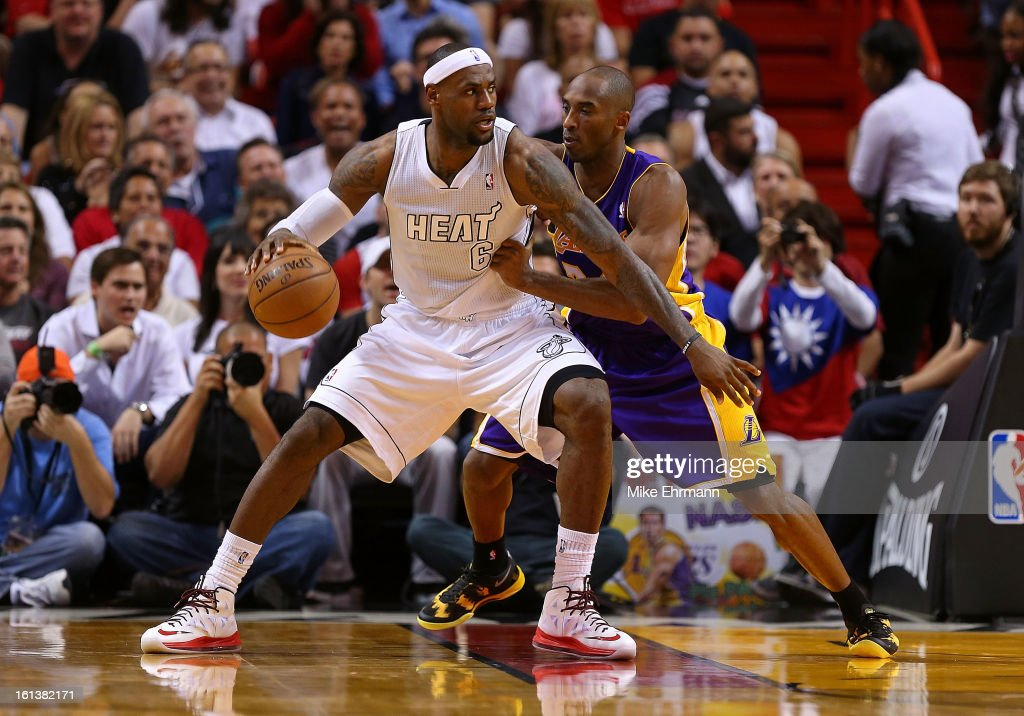 Kobe Bryant #24 of the Los Angeles Lakers guards LeBron James #6 of the Miami Heat during a game at American Airlines Arena on February 10, 2013 in Miami, Florida.