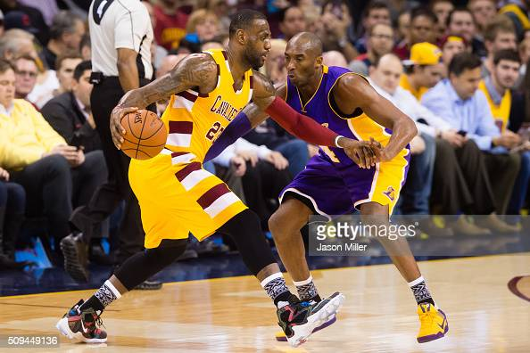 Kobe Bryant of the Los Angeles Lakers guards LeBron James of the Cleveland Cavaliers during the first half at Quicken Loans Arena on February 10 2016...