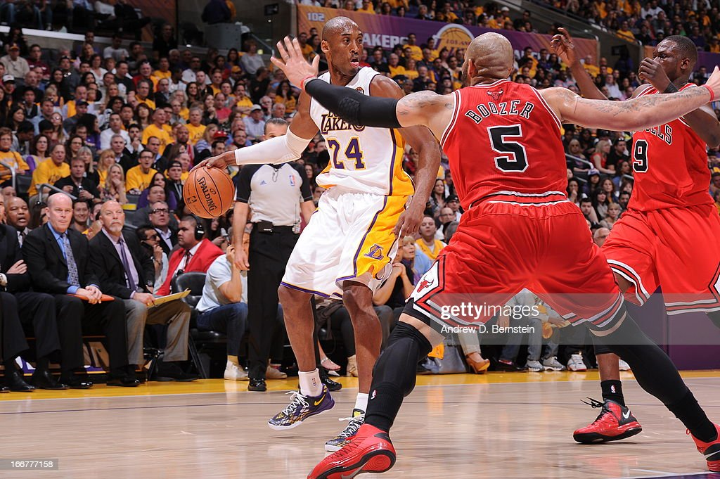 <a gi-track='captionPersonalityLinkClicked' href=/galleries/search?phrase=Kobe+Bryant&family=editorial&specificpeople=201466 ng-click='$event.stopPropagation()'>Kobe Bryant</a> #24 of the Los Angeles Lakers handles the ball against <a gi-track='captionPersonalityLinkClicked' href=/galleries/search?phrase=Luol+Deng&family=editorial&specificpeople=202830 ng-click='$event.stopPropagation()'>Luol Deng</a> #9 and <a gi-track='captionPersonalityLinkClicked' href=/galleries/search?phrase=Carlos+Boozer&family=editorial&specificpeople=201638 ng-click='$event.stopPropagation()'>Carlos Boozer</a> #5 of the Chicago Bulls at Staples Center on March 10, 2013 in Los Angeles, California.