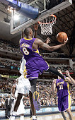 Kobe Bryant of the Los Angeles Lakers handles the ball behind the backboard against the Dallas Mavericks on December 12 2005 at the American Airlines...