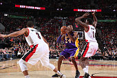 Kobe Bryant of the Los Angeles Lakers handles the ball during the game against the Portland Trail Blazers on November 28 2015 at the Moda Center in...