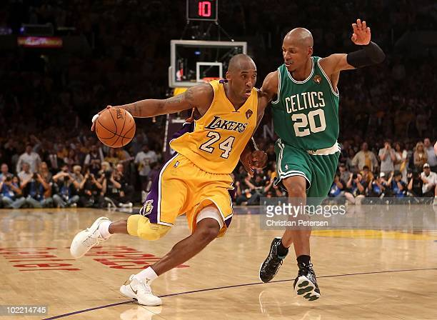 Kobe Bryant of the Los Angeles Lakers handles the ball under pressure from Ray Allen of the Boston Celtics in Game Seven of the 2010 NBA Finals at...
