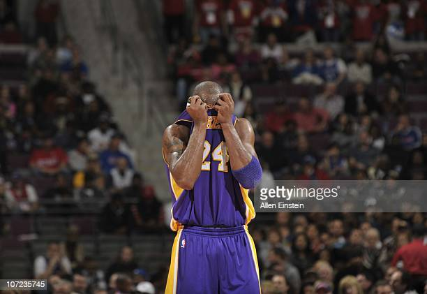Kobe Bryant of the Los Angeles Lakers hides his face in his jersey against the Detroit Pistons on November 17 2010 at The Palace of Auburn Hills in...