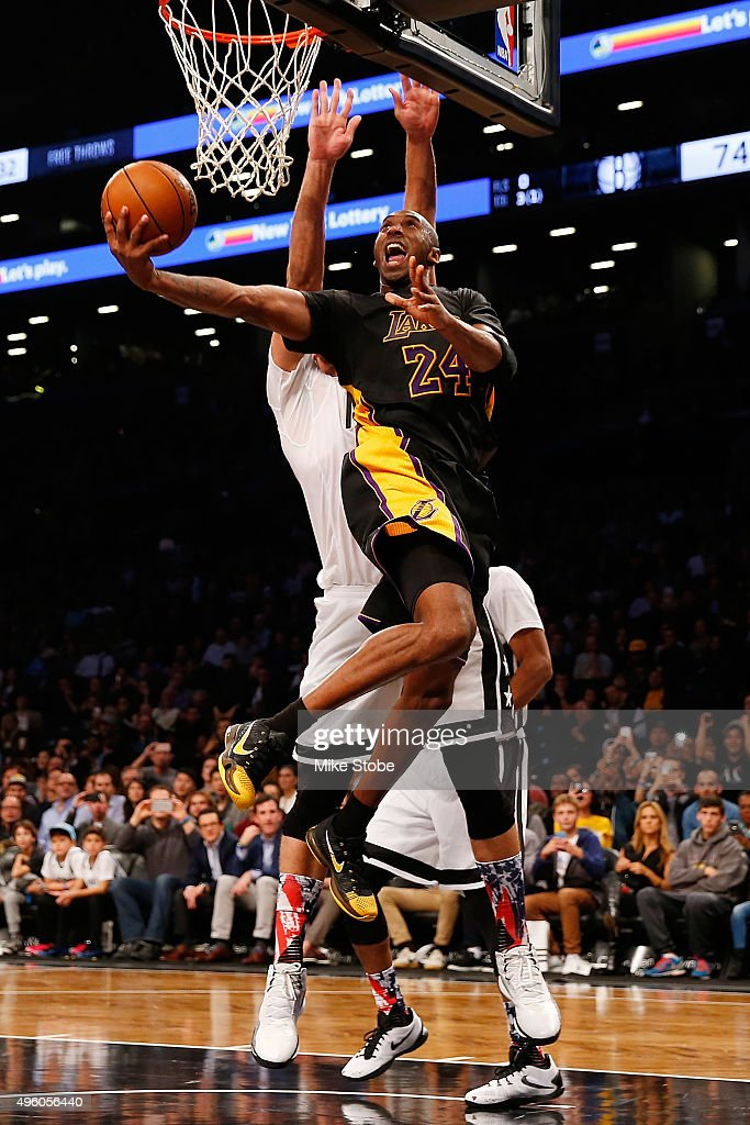 Kobe Bryant of the Los Angeles Lakers hits a basket against the Brooklyn Nets at the Barclays Center on November 6 2015 in the Brooklyn borough of...