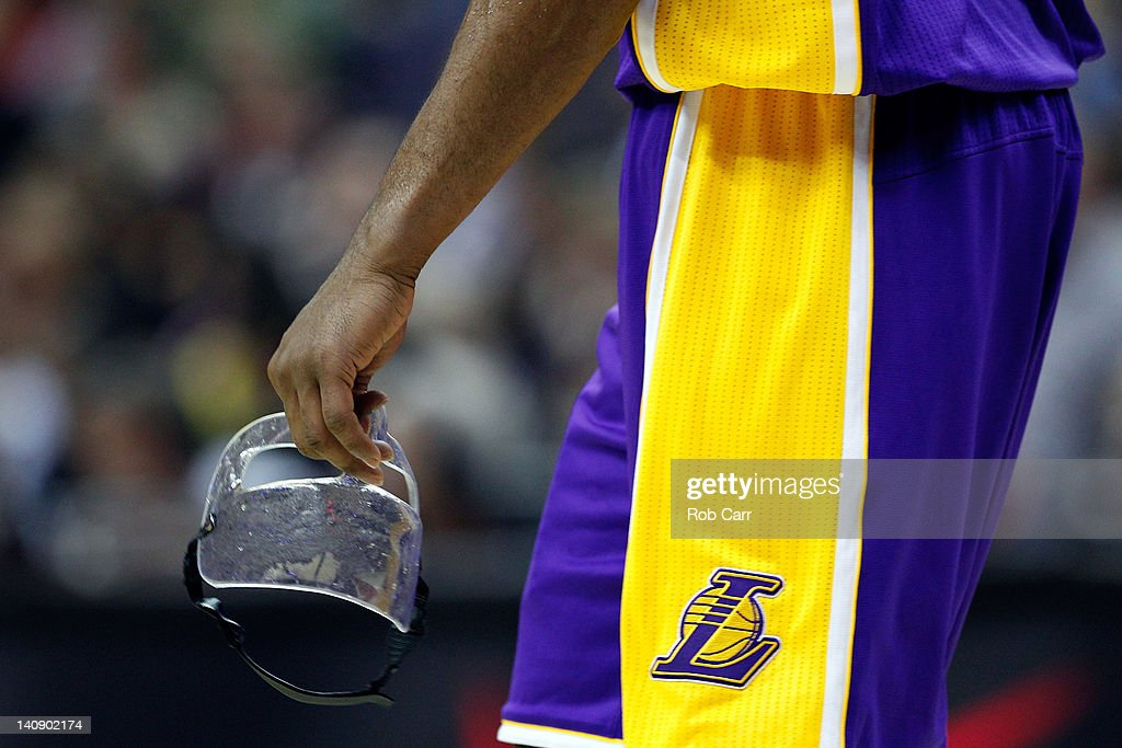 <a gi-track='captionPersonalityLinkClicked' href=/galleries/search?phrase=Kobe+Bryant&family=editorial&specificpeople=201466 ng-click='$event.stopPropagation()'>Kobe Bryant</a> #24 of the Los Angeles Lakers holds his face mask during the second of the Lakers loss to the Washington Wizards at the Verizon Center on March 7, 2012 in Washington, DC.